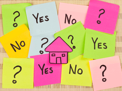 Post-it notes questioning whether to buy a home or not