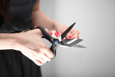 Image of somebody cutting up a credit card
