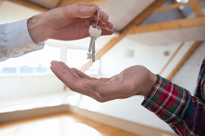 A new homeowner getting keys