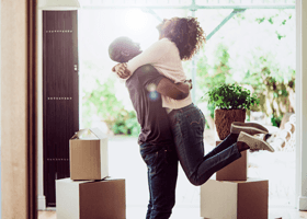 Two people celebrating moving into their new house