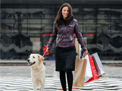 Woman shopping with her dog