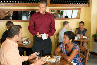 Image of an unimpressed couple talking to a waiter