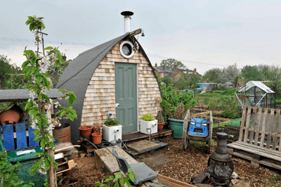 An arched-roof shed on an allotment