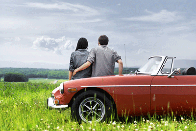 Couple next to red MGB