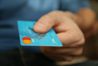 Image of a hand holidng a credit card