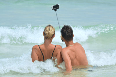 Image of a couple taking a selfie in the sea