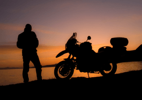 A motorcycle in a sunset