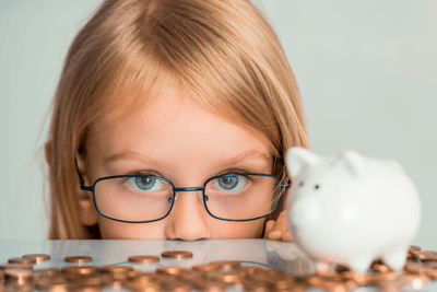 A girl counting coins