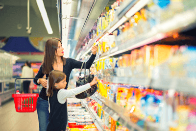 A woman in the supermarket with her daughter