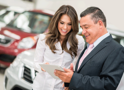 Image of a woman talking to a car dealer