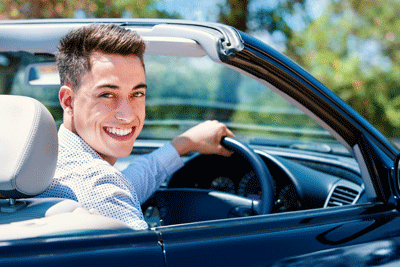 Image of a man delighted with his new car