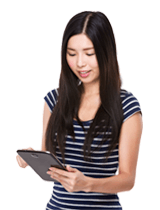 Image of a woman looking at a tablet