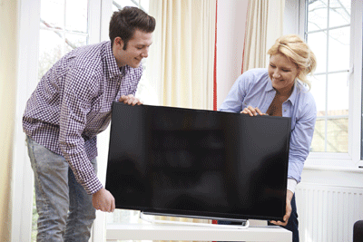 Image of people placing new telly down