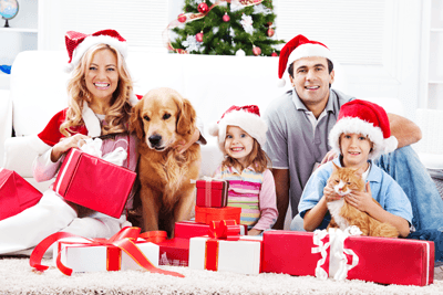 Image of a family with a dog at Christmas