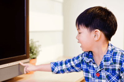 Image of a child turning off a television
