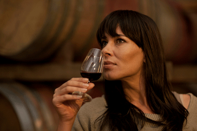 Image of a woman sniffing wine