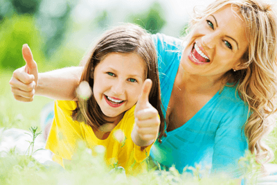 Image of a woman and daughter giving the thumbs up