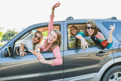 Image of friends in a car