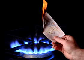 Image of someone setting fire to a tenner