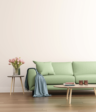 Image of sofa with fresh flowers on table