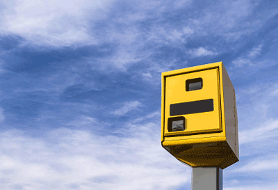 Image of a yellow speed camera