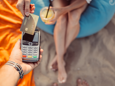 A contactless payment on a beach