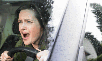 Image of an angry woman at the wheel