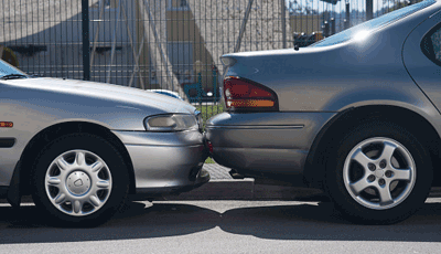 Image of two cars parked closely together