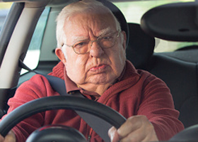 Image of disgruntled man in car