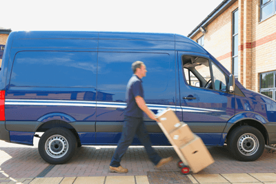 Courier unloading boxes from van