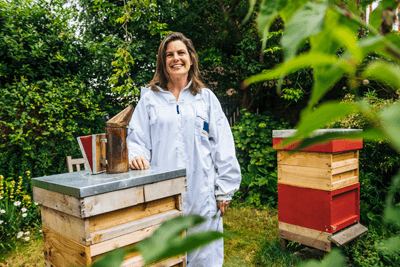 Image of a female beekeeper