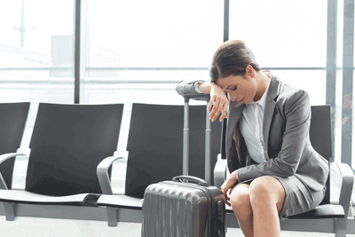 Image of depressed woman at airport