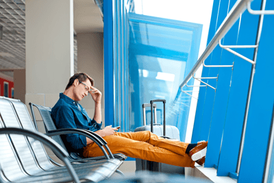 stressed man at airport