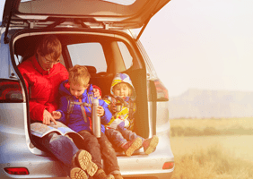 An image of a family having a cup of tea in the car